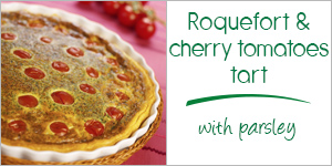 Roquefort tart with cherry tomatoes and parsley