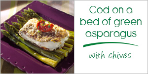 Cod on a bed of green asparagus with chives